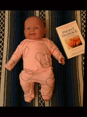 A doll is Brenda Amador Schulz' tool for teaching infant massage.
