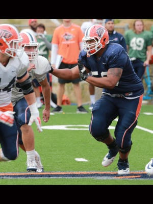 UTEP offensive lineman Greg Long heads downfield to block for a teammate Tuesday.