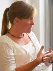 Parent Crystal Wright of Bridgewater interacts with the group during a peaceful parenting support group meeting at the Raw Learning Center in Staunton on Aug. 26, 2016.