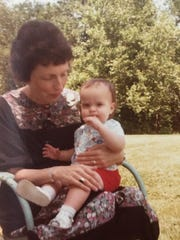 Sarah Roberson is held by her mother, Peggy Roberson, in an undated photo of her as a child.