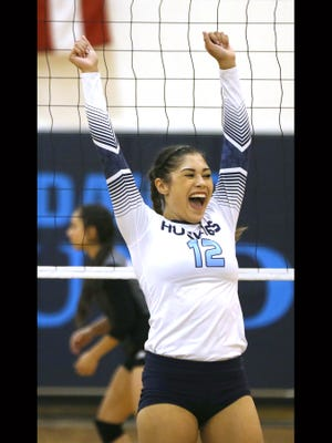 Chapin's Alyssa Lozoya celebrated a point in the Huskies match against Horizon Tuesday at the Huskies' gym.