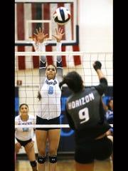 Chapin's Vivien Marquez, left, leaps to block a shot