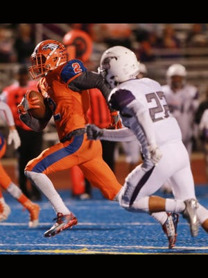 Canutillo receiver Joseph Paz sprints away from Eastlake defender Eric Fierro to score a second quarter touchdown Friday.