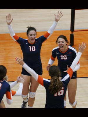 UTEP's Brianna Arellano, top left, Kylie Baumgartner, top right, and Lindsey Larson celebrate the clinching point in the second game of their match against Florida Atlantic Sunday.