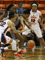 UTEP's Chanel Khammarath, left, steals the ball from Texas Southern's Isis Lane Sunday. UTEP's Sparkle Taylor is at right.