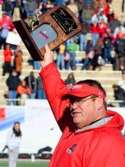 Riverheads' head coach Robert Casto holds high the