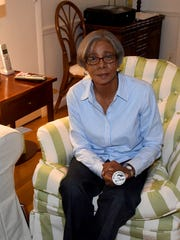 """Lee holds her button from """"March On Washington for Jobs & Freedom"""" which she participated in during August 1963."""