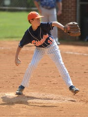 Staunton's Kaden Welcher delivers a pitch during the Babe Ruth Cal Ripken 12-year-old Southeast Regional in 2014. Babe Ruth Baseball and the VHSL adopted pitch-count rules in early December that will go into effect for their programs starting in the 2017 season.
