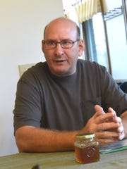 Glenn Rodes talks about the benefits of growing hemp during an interview on Dec. 12, 2016.