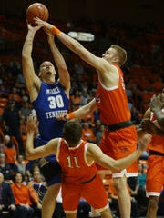 Middle Tennessee's Reggie Upshaw, top left, charges into UTEP defender Jake Flaggert Saturday Feb. 4, 2017 in El Paso, Texas. UTEP's Kelvin Jones is at right.