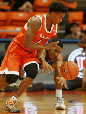 UTEP's Omega Harris avoided a sprawling steal attempt by Middle Tennessee's Edward Simpson during the first half Saturday Feb. 4, 2016 in El Paso, Texas. (AP Photo/El Paso Times, Victor Calzada)