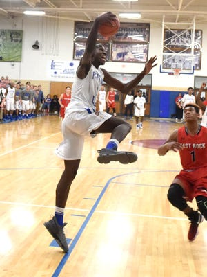 Robert E. Lee's Darius George goes up with the ball for a slam dunk during a Conference 36 championship game played in Staunton on Saturday, Feb. 11, 2017.