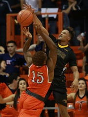 "Southern Miss defender Cortez Edwards blocks a shot attempt by UTEP""s Dominic Artis during the first half Saturday."