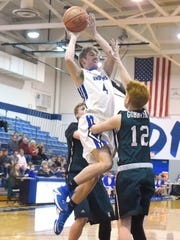Fort Defiance's Jacob Jones goes up and shoots as Broadway's Jacob Terry guards during a Conference 29 quarterfinal game played in Fort Defiance on Saturday, Feb. 13, 2017.