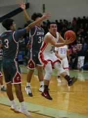 Anthony's Isaiah Montanez puts up a shot against two
