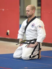 Master Dan Napier, a 5th degree black belt in Tae Kwon Do, quiets his mind as he holds a meditative pose during a class at the Dong's Martial Arts studio in Staunton on Feb. 3, 2017.