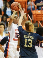 UTEP's Sparkle Taylor scores over FIU defender Janka Hegedus during the first quarter Saturday.