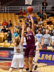 Stuarts Draft's Monique Ayres takes the ball up and shoots as Floyd County's Hannah Altizer guards during a Group 2A state quarterfinal game played at James Madison University on Thursday, March 2, 2017.