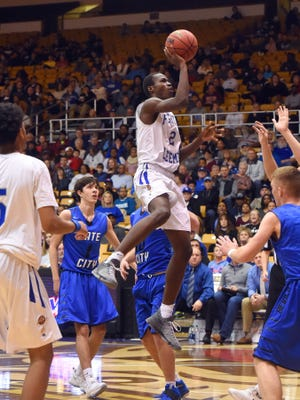Robert E. Lee's Darius George gets height as he slips through and shoots during a Group 2A state quarterfinal basketball game played at James Madison University on Friday, March 3, 2016.