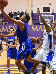 Robert E. Lee's Jayden Williams reaches for the basket during a Group 2A state semifinal basketball game played at James Madison University on Friday, March 4, 2017.