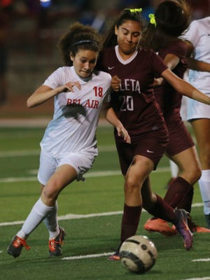 Bel Air's Nicole Cohen and Ysleta's Blanca Serrano race for the ball Tuesday.