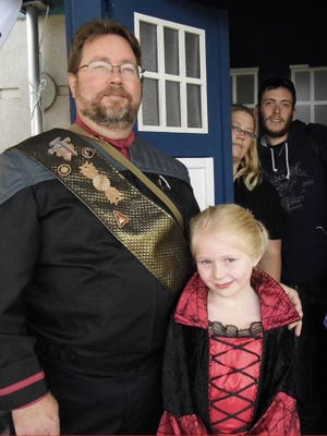 News Leader photographer Mike Tripp dressed in a Starfleet uniform along with daughters Abigail and Amy Tripp as well as David Stathos Ñ some of the members of a local Star Trek fan group, named U.S.S. Sam Houston.