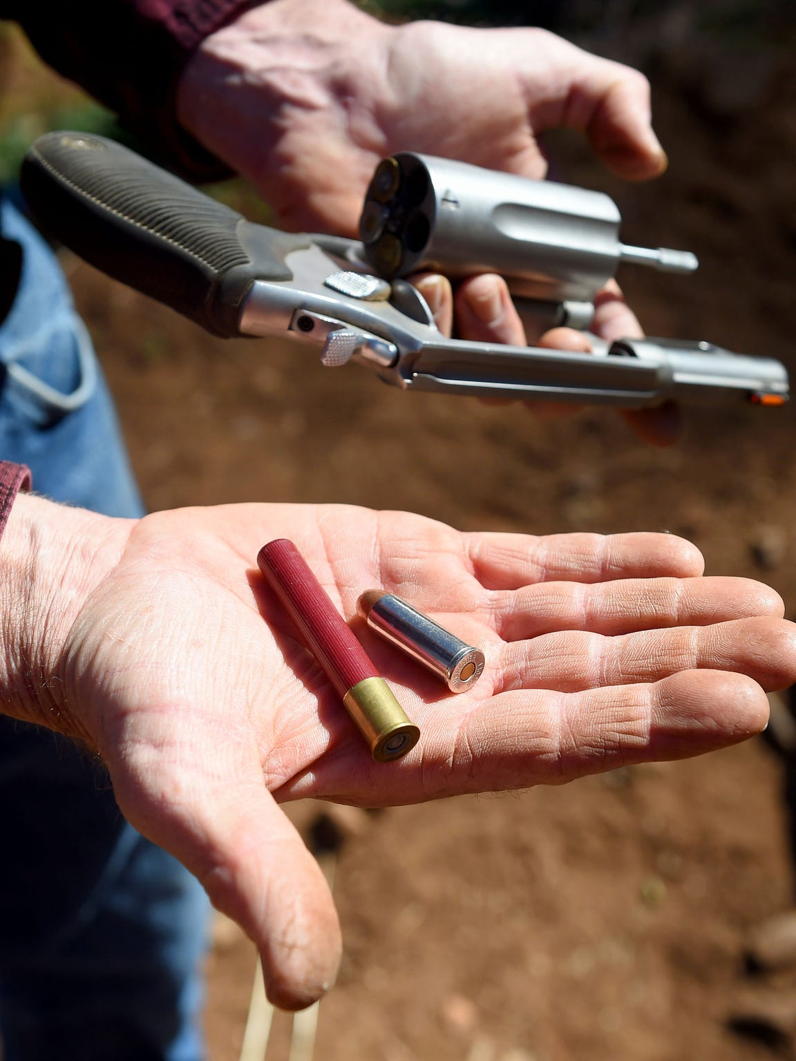 Jace Goodling shows the two types of bullets his Taurus