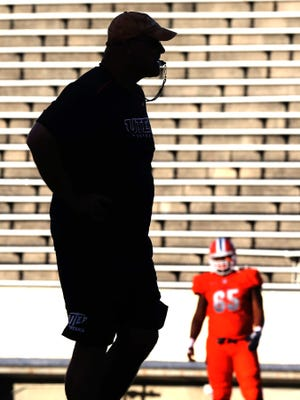 Head coach Sea Kugler watches his team during Friday's scrimmage.