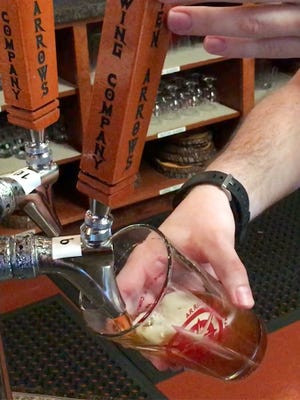 A glass of beer is poured from the tap at Seven Arrows Brewing Company in Waynesboro on April 21, 2017.