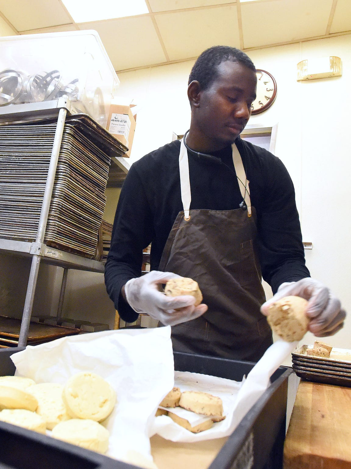Abdelrahman Abshir works as a baker at Panera Bread in Charlottesville, Va., on Wednesday, May 3, 2017. Having lived in Waynesboro since January, he has been on the move since since he was a boy with the conflict in his home of Darfur, Sudan, pushing him out.