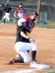 Wilson Memorial's Emma Peery slides safely into third base Tuesday. Wilson beat Stonewall Jackson 11-1 in the Shenandoah District game.