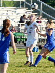 Stuarts Draft's Hannah Chatterton heads the ball during