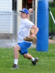 Derek Duffy, a sophomore Franklin Pierce University, gets some warmup throws in Tuesday night during a Staunton Braves practice.