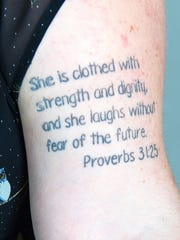 Laura Peters has Proverbs 31:25 tattooed on her upper arm.