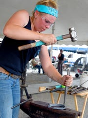 Ally Lacey of Harrisonburg competes in the HOT AUGUSTa Farriers Contest held at the Augusta County Fair on Friday, Aug. 4, 2017. This marks her first year of competition.