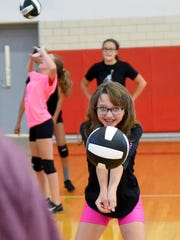 Eighth-grader Shellie Simonetti bumps the ball as the team does drills during practice at Shelburne Middle School on Tuesday, Aug. 29, 2017.