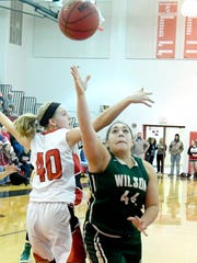Wilson Memorial's Sarah Sondrol shoots and scores her 1,000 point during a game against Riverheads, played in Greenville on Thursday, Jan. 18, 2018.