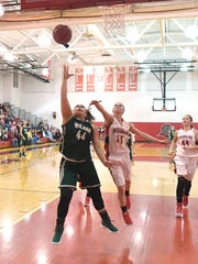 Wilson Memorial's Sarah Sondrol shoots and scores another basket on her way to 1,000 points during a game against Riverheads, played in Greenville on Thursday, Jan. 18, 2018.