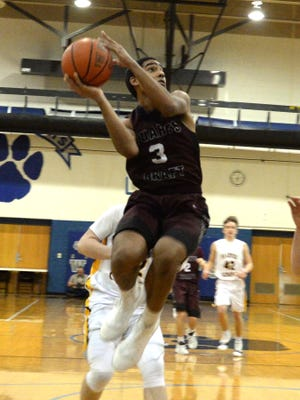 Stuarts Draft's Colin Williams takes off for a shot in Saturday's Rock the Ribbon game against Floyd County.