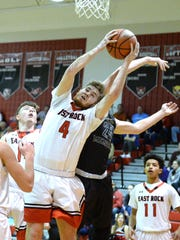 East Rockingham's Collin Wigley pulls down a rebound Friday night during a win over Wilson Memorial.