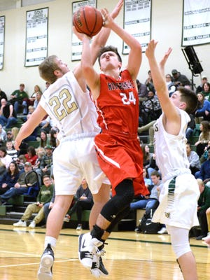 Riverheads' Grant Painter (24) goes between a pair of Wilson Memorial defenders Friday night during a Shenandoah District Tournament quarterfinal game