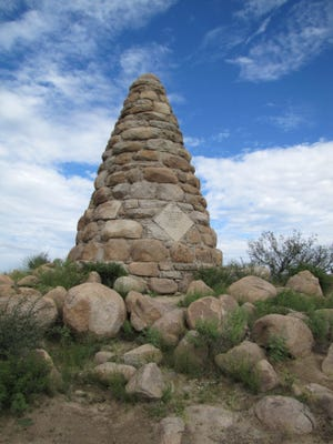Ed Schieffelin who first discovered ore in Tombstone was buried, per his request, in prospector clothes with pick and canteen beneath a memorial similar to those built atop mining claims. It is located 3 miles east of Tombstone.