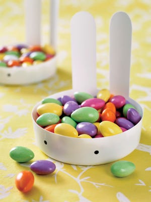 A candy caddy is made from a 32-ounce yogurt container.
