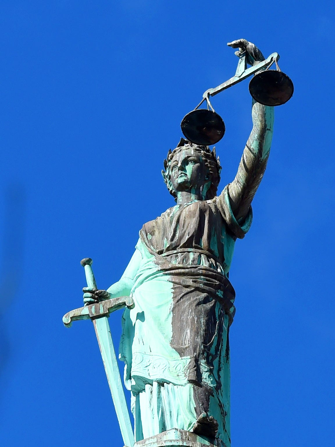 The form of Lady Justice on top of he Augusta County