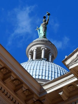 The form of Lady Justice on top of he Augusta County Courthouse in Staunton on Friday. The form of Lady Justice on top of he Augusta County Courthouse located in downtown Staunton. Photograph taken on Friday, Jan. 16, 2015.
