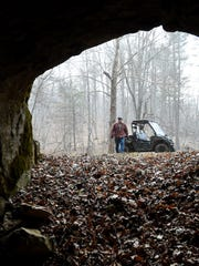 Avid caver Phil Lucas approaches Owl Cave, one of the caves on his property in Highland County, on Thursday, Feb. 12, 2015.