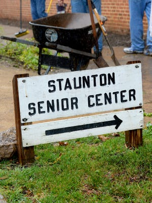 A sign marks an entrance to the Staunton Senior Center as landscaping work takes place around it on Tuesday, Oct. 14, 2014.