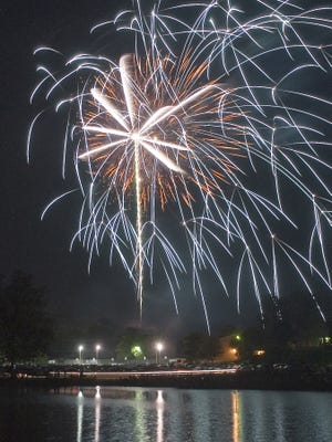 Following the last concert, fireworks lit the sky over Tams Lake at Gypsy Hill Park as part of the America's Birthday Celebration on Tuesday, July 4, 2006.