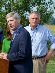 Delegate Steve Landes of the 25th district addresses those gathered as Gov. Terry McAuliffe listens during a press conference at Cave View Farm in Weyers Cave on Monday, August 25, 2014.