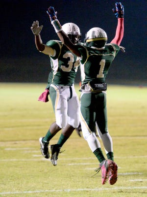 Wilson Memorial's Savant Swift, left, celebrates with teammate Juh-Kwquan McCauley who just scored a touchdown during a football game played in Fishersville on Friday, Oct. 10, 2014.